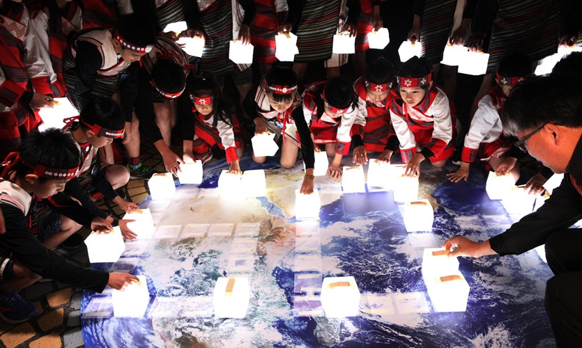Indigenous children's choir casts through the darkness to shine a light on climate change.